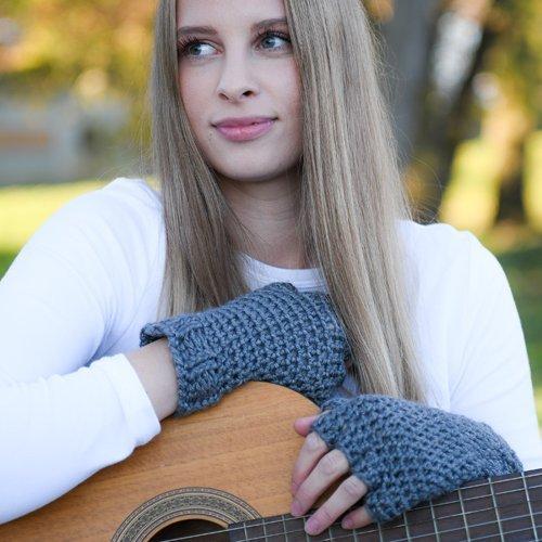 Denim Blue Finger Gloves - modeled - hands leaning on a guitar - closeup