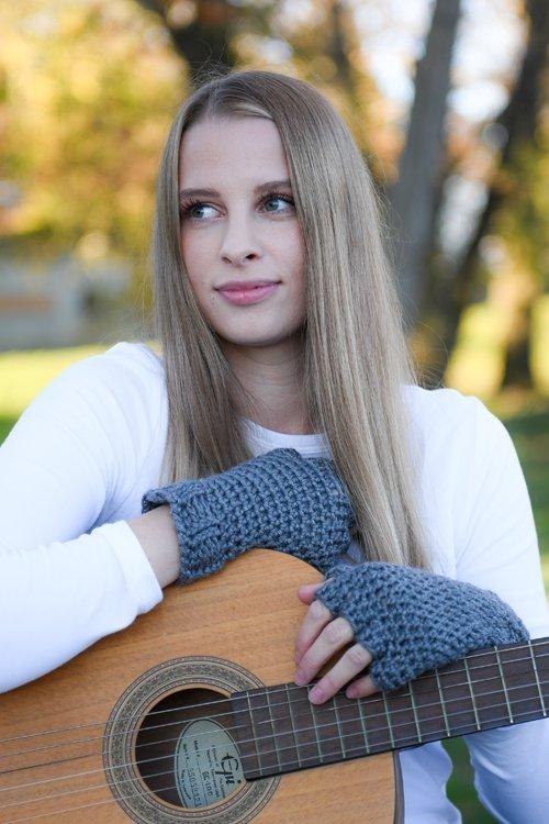 Denim Blue Finger Gloves - modeled - hands leaning on a guitar