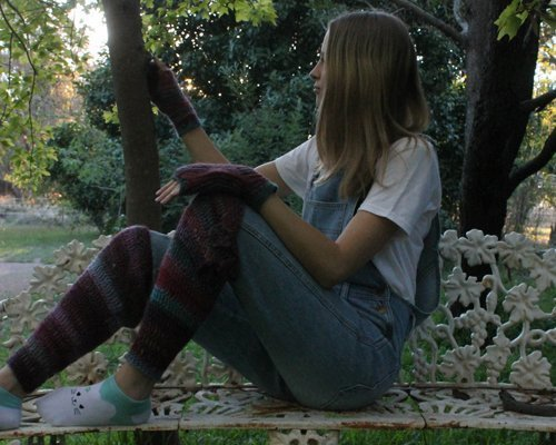 Pink Rainbow Leg Warmers - on girl sitting on a garden seat at sunset