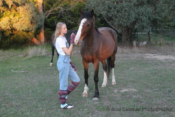 Pink Rainbow Leg Warmers - on girl standing near a horse
