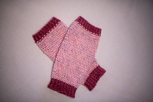 Pink and Cerese Valley Leg Warmers laid flat, crossed over each other 3