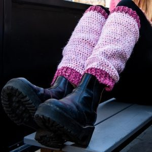 Pink and Cerise Valley Leg Warmers on woman with feet down on a step