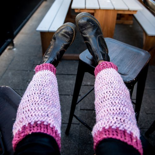 Pink and Cerese Valley Leg Warmers on woman with feet on a stool