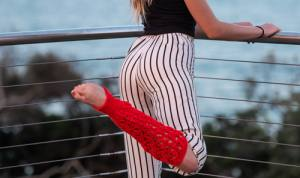 Red Laketown Socks on woman standing - close up against a fence