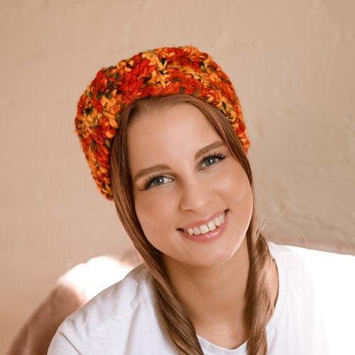 Frosty Morning Head Wrap in Rainbow. Front shot on smiling model