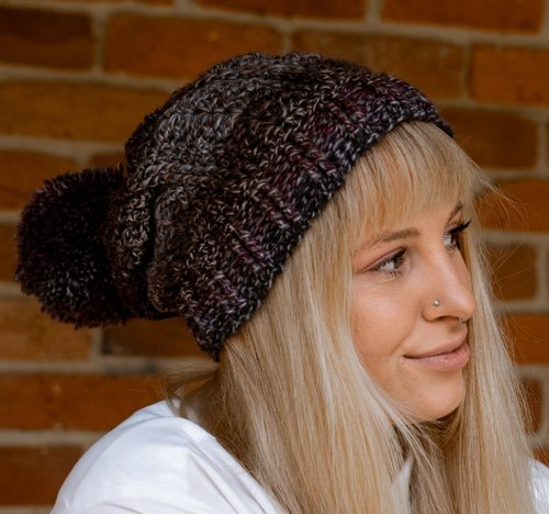 Bloomin' Comfy Beanie - With Pompom - cuff flat - on model from the side - closeup