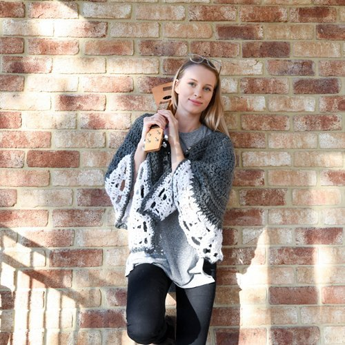 Nordic Escape Cape - in Charcoal Grey and White - Model with Ukelele
