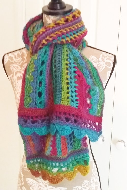 Riotous Wrap - or scarf - in Fab - Styling - Tied at neck ends splayed over chest - available from MadeforYOUbyFi April 2021