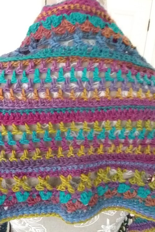 Riotous Wrap - or scarf - in Fab - close up of design - from the back - available from MadeforYOUbyFi April 2021