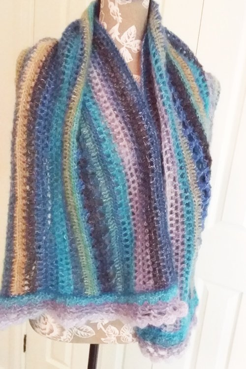 Sandbars in the Tropics Shawl - ends splayed over chest - available from MadeforYOUbyFi April 2021